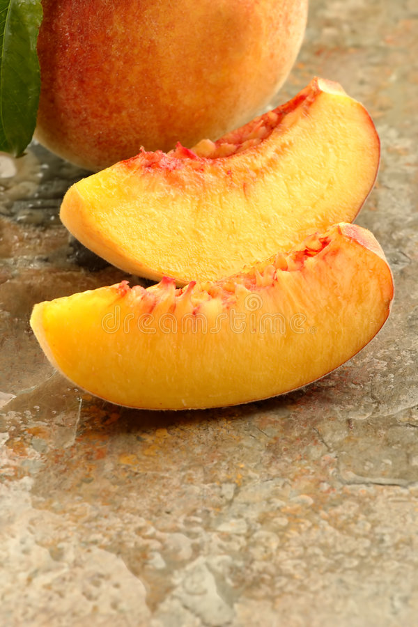 Fresh peach slices stock images