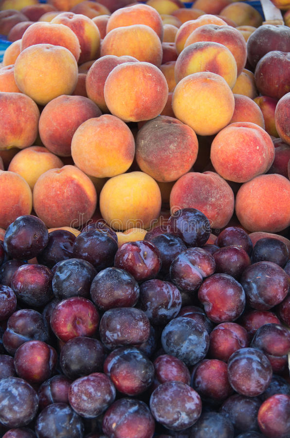 Fresh peaches and plums. Detail of fresh peaches and plums stock photos