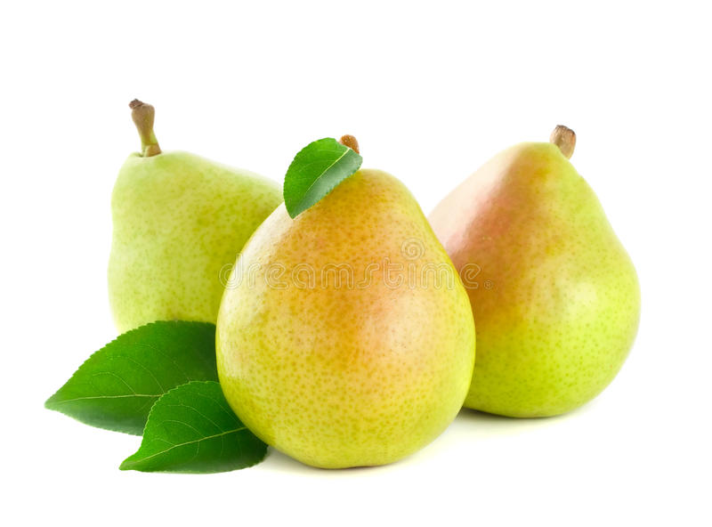 Fresh pear with green leaves royalty free stock image
