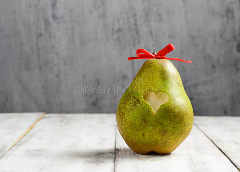 Fresh pear with heart for Valentine day. Ripe fresh pear with heart for Valentine day royalty free stock image