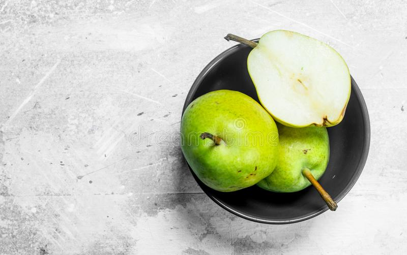 Fresh pears in the bowl stock photo