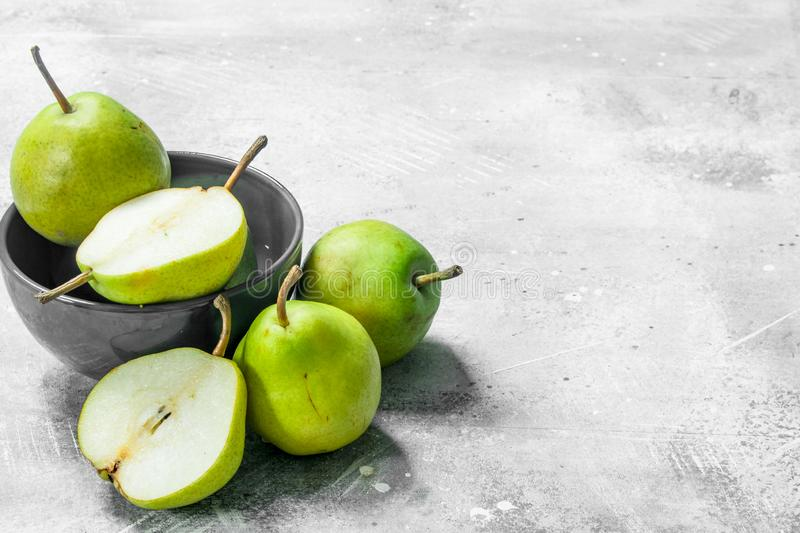 Fresh pears in the bowl stock image