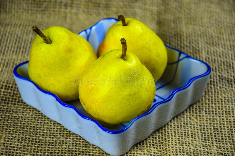 Fresh pears in a ceramic bowl stock photo