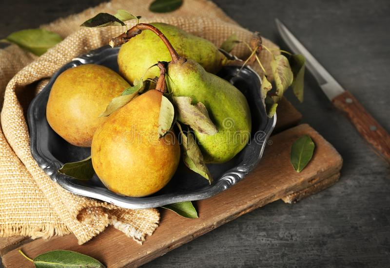 Fresh pears in bowl on grey background royalty free stock images