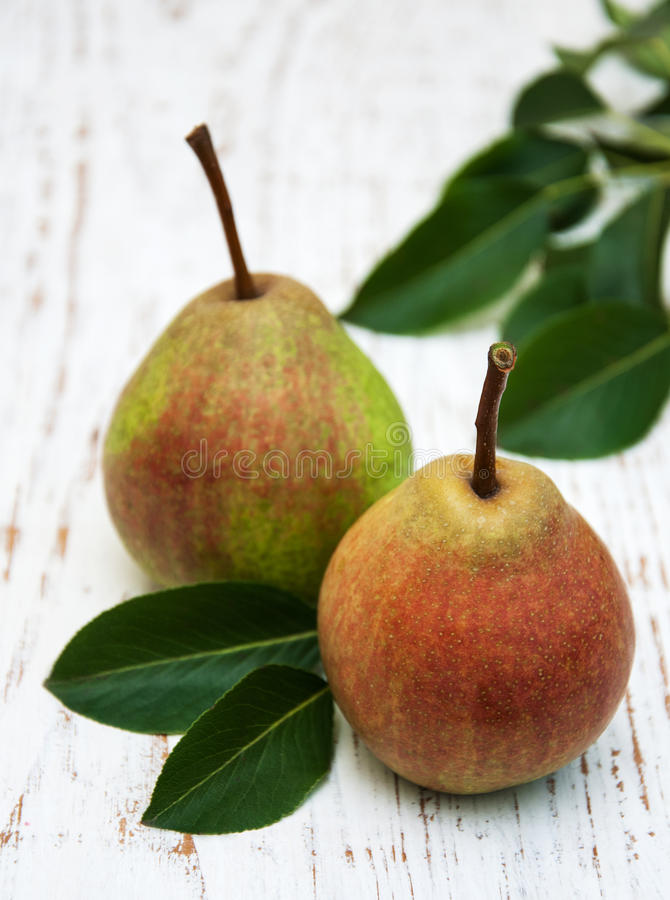 Fresh pears. On a old wooden background stock photo