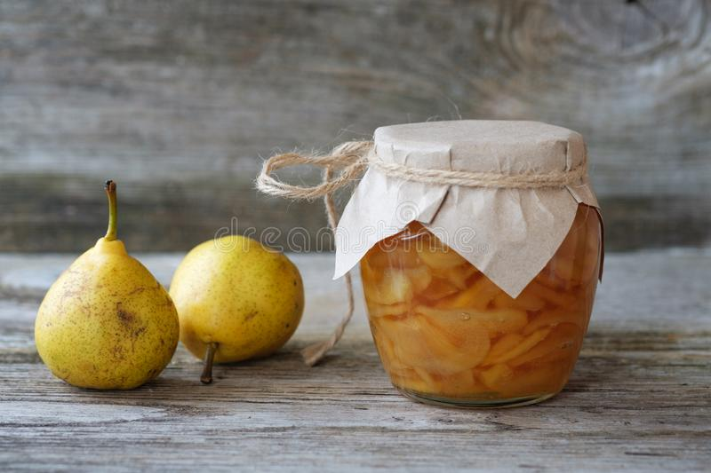 Fresh pears and pear jam royalty free stock image