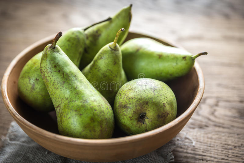 Fresh pears in the rustic bowl royalty free stock image