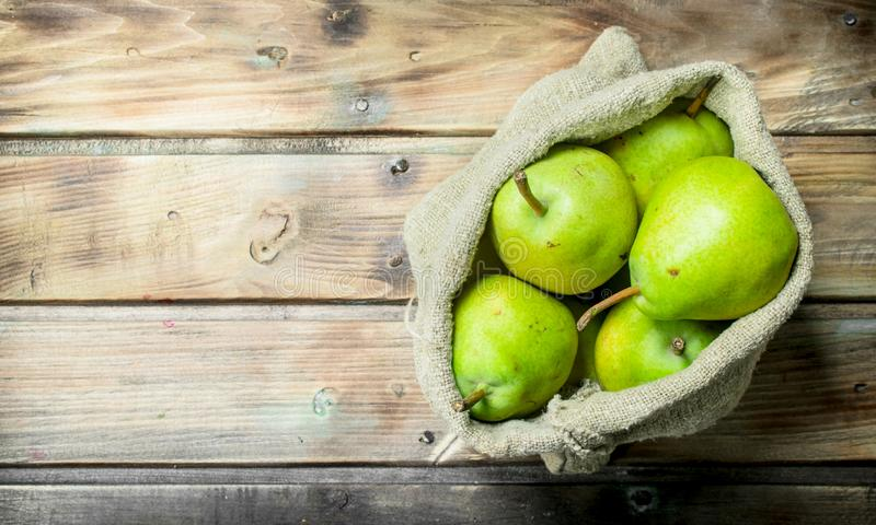 Fresh pears in the sack stock image