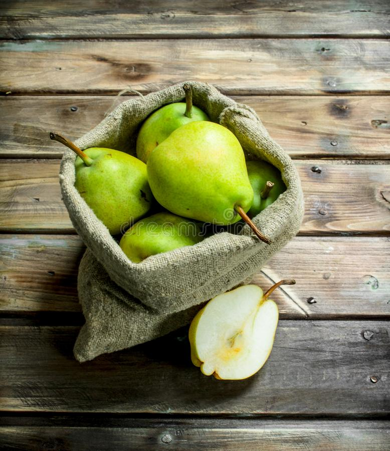 Fresh pears in the sack stock photo