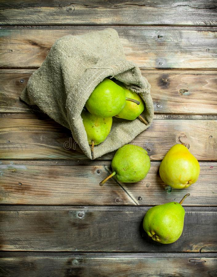 Fresh pears in the sack stock images