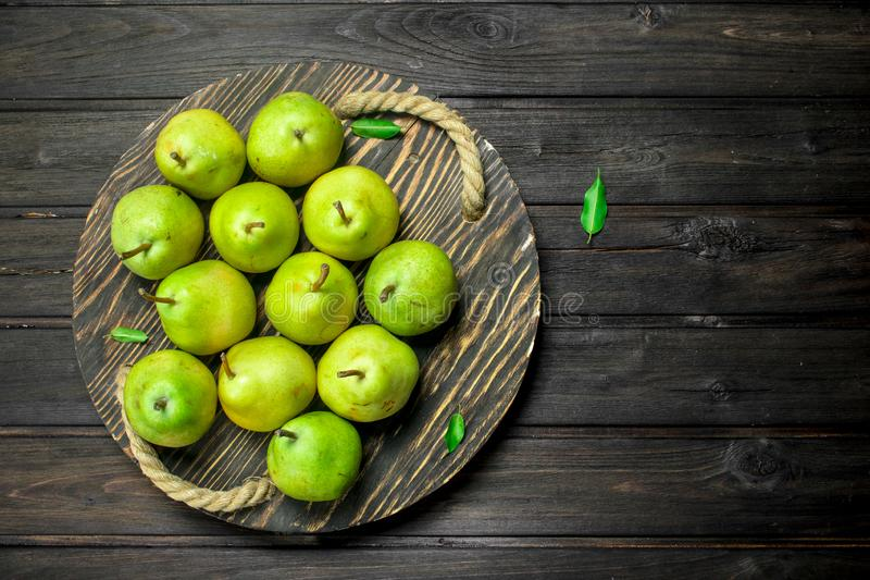 Fresh pears on tray stock images