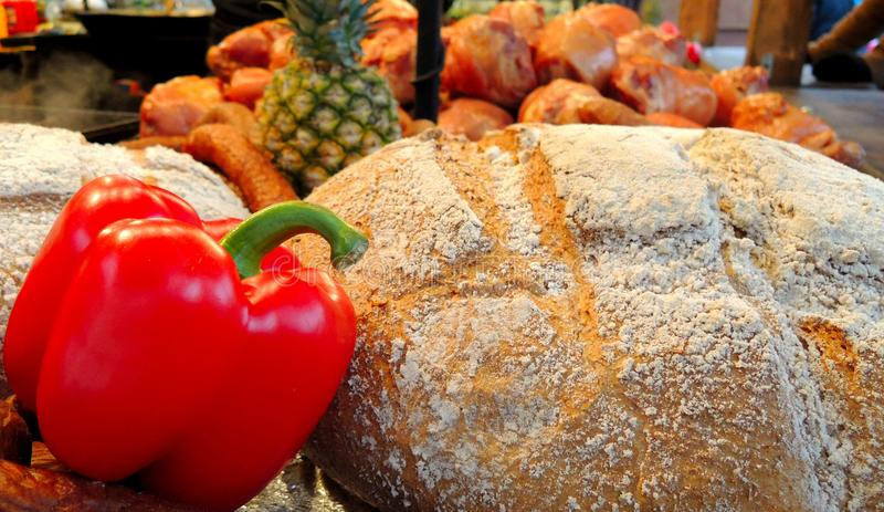 Fresh pepper with crisp bread. Clear photo of fresh red pepper with crisp bread with background full of other food stock image