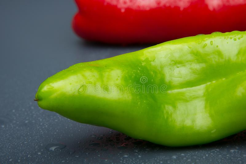 Fresh pepper, fresh from the garden. The green pepper, still needs to mature in the bush, but it is perfectly consumable and can be eaten. The red pepper, is stock photography