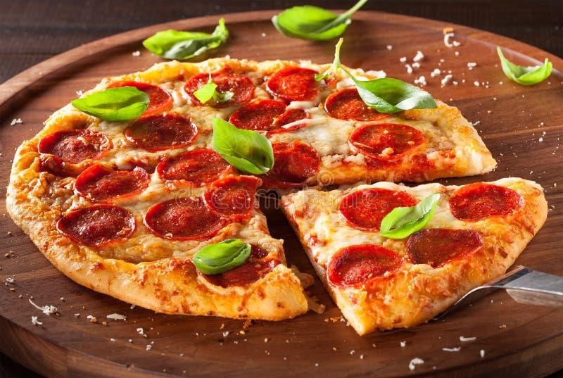 Fresh Pepperoni Pizza with Fresh Basil royalty free stock photos