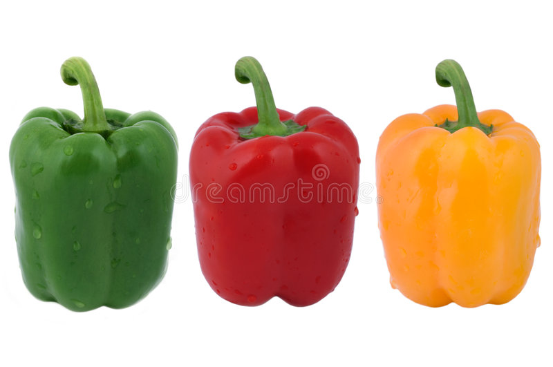 Fresh peppers. Fresh green, red and yellow peppers with water drops isolated on white background royalty free stock photos