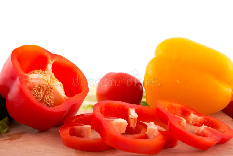 Fresh peppers cuts on white background stock image