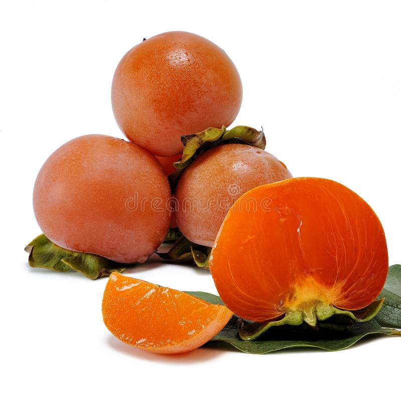 Fresh persimmons on white background stock photo