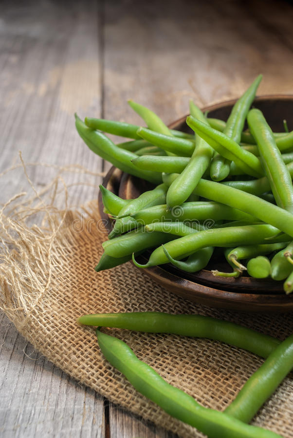 Fresh picked green beans on a wooden table. Freshly picked green beans on a wooden table stock image