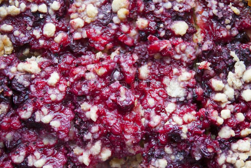Fresh pie cramble with berries close-up royalty free stock photo