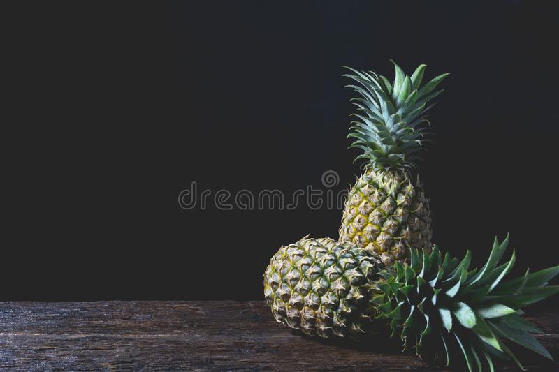 Fresh pine apple, vitamin and good for health on wooden table royalty free stock image