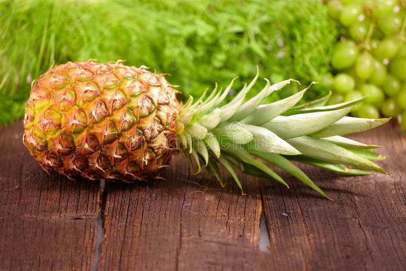 Fresh pineapple. On wooden board, horizontal view royalty free stock images