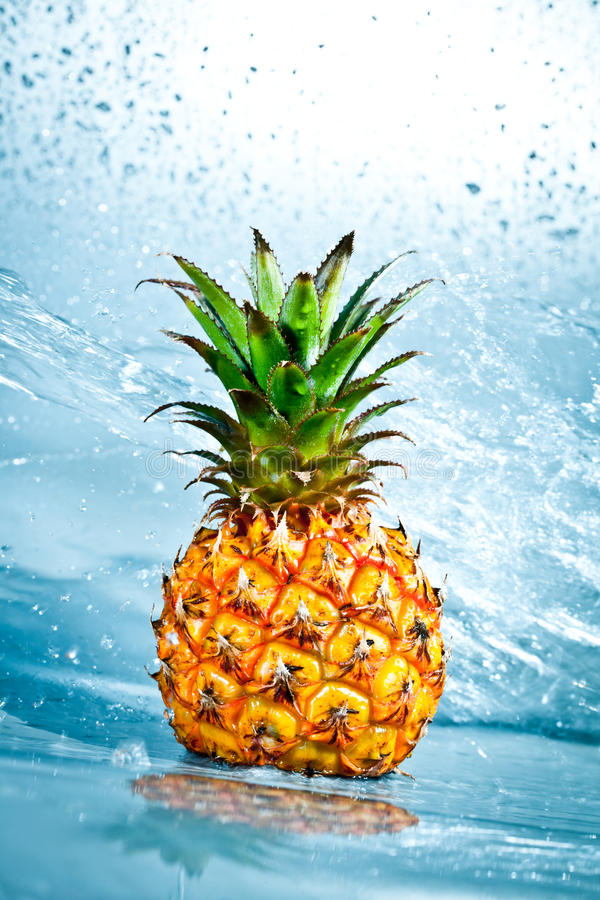 Fresh pineapple. In water splashes royalty free stock photography