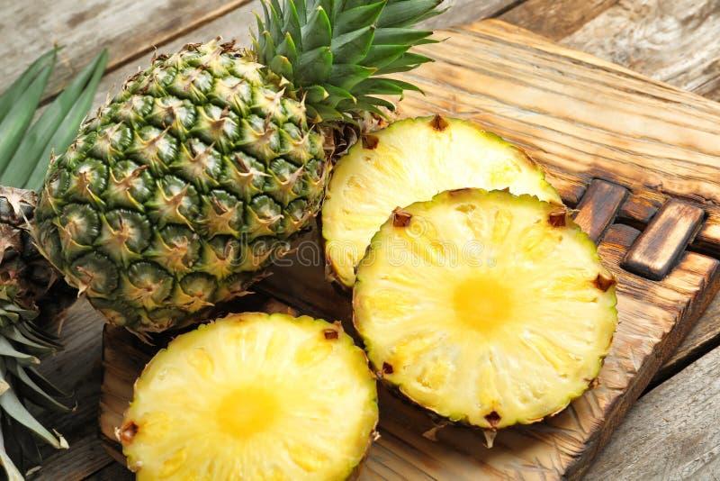 Fresh pineapple on board. Fresh pineapple on wooden board stock photography