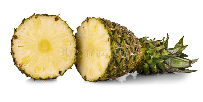 The fresh pineapple cut in half on white background stock photo