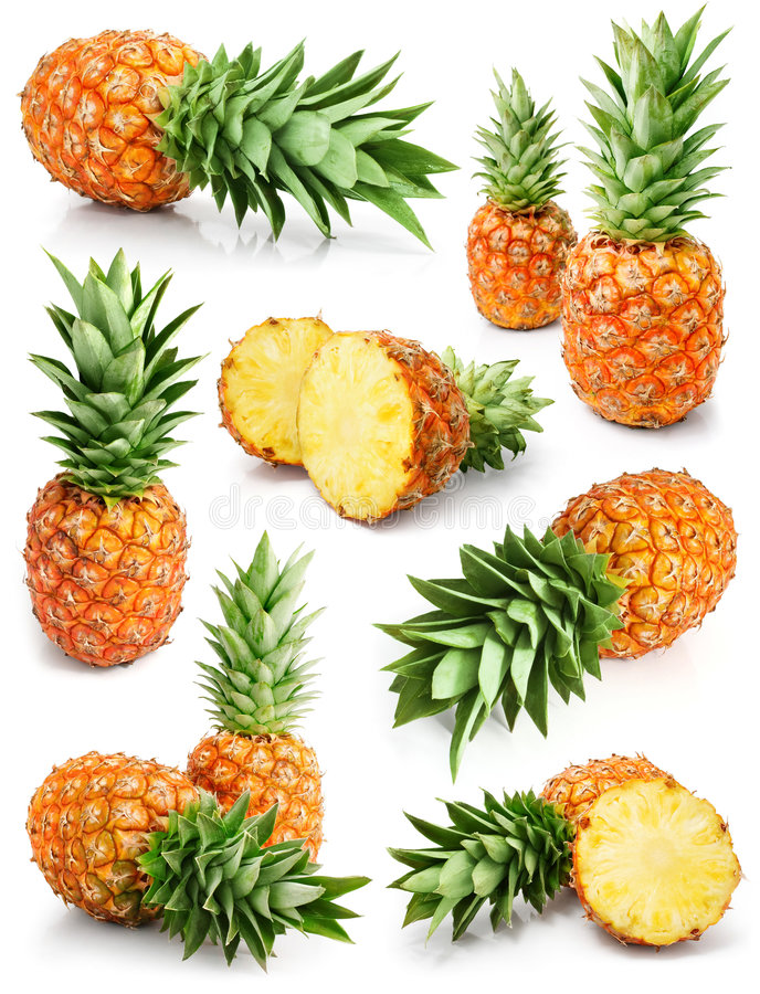 Fresh pineapple fruits with cut and green leaves. Isolated on white background stock photo