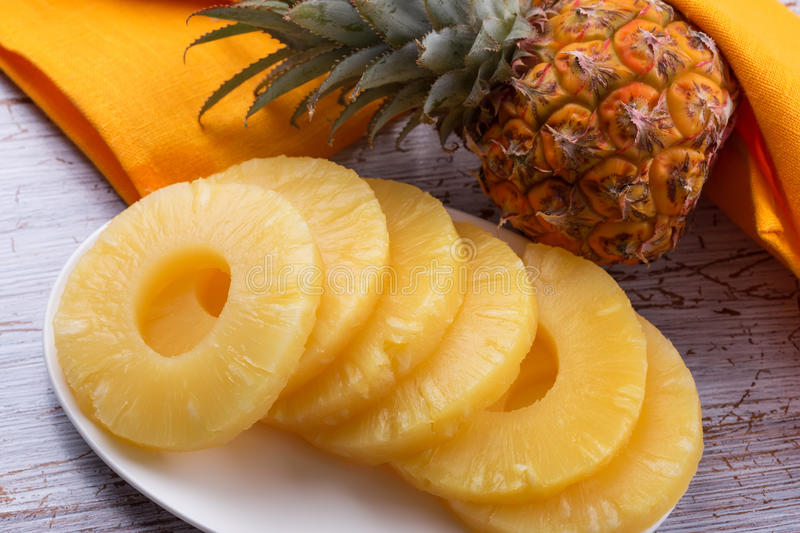 Fresh pineapple. Fresh ripe pineapple (ananas) on wooden background. Selective focus royalty free stock photo