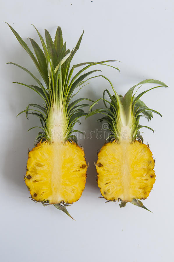 Fresh pineapple with slices on the table stock photo