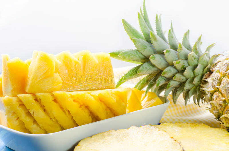 Download Fresh Pineapple With Slices On White Background Stock Photo - Image: 83701382