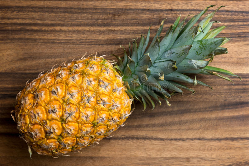 Fresh pineapple. Fresh whole pineapple on wooden board royalty free stock photos