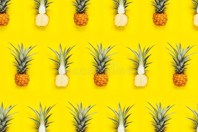 Fresh Pineapple In the yellow background Pineapple pattern.  stock photography