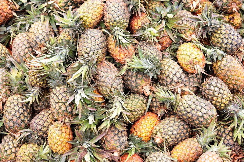 Fresh pineapples at an outdoor market