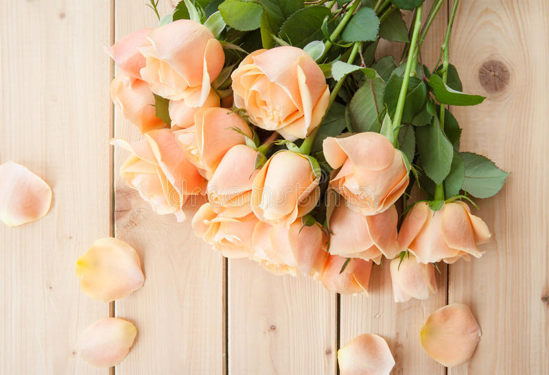Fresh pink roses. On rustic wooden background stock photography