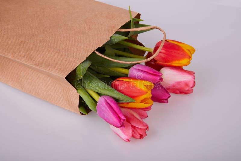 Fresh pink tulip flowers in paper bag. royalty free stock image