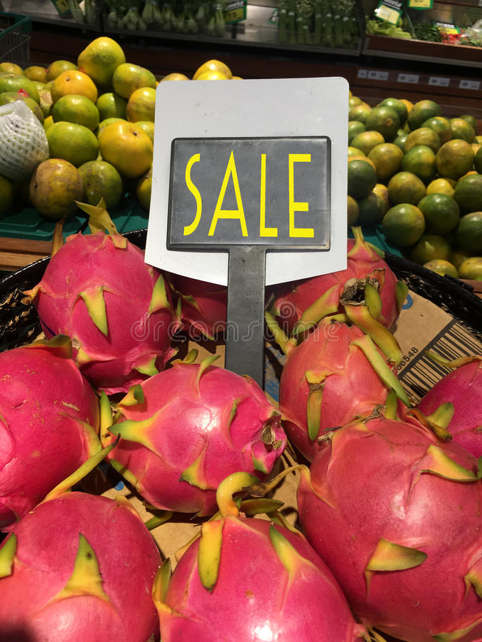 Fresh pitahaya. Heap with sale label in the maket store stock photography
