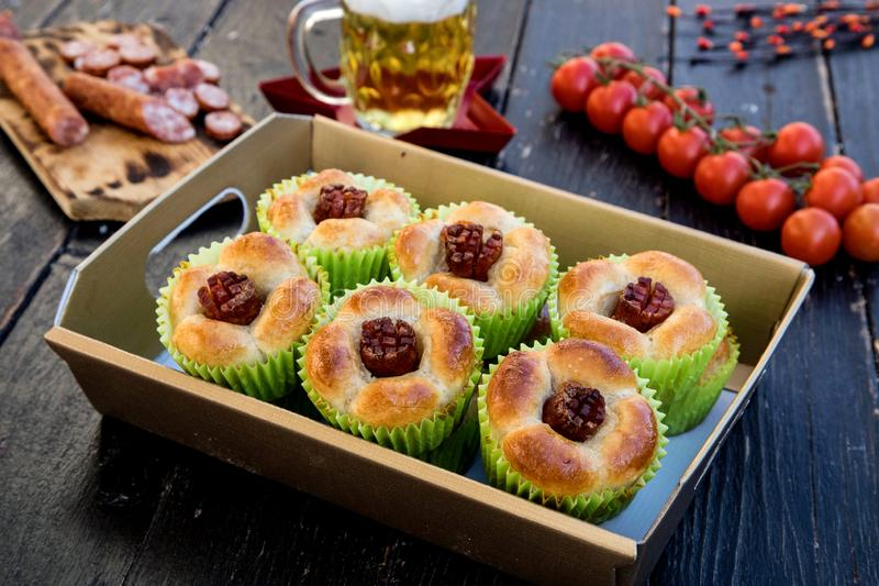 Fresh pizza muffins with sausages stock photo