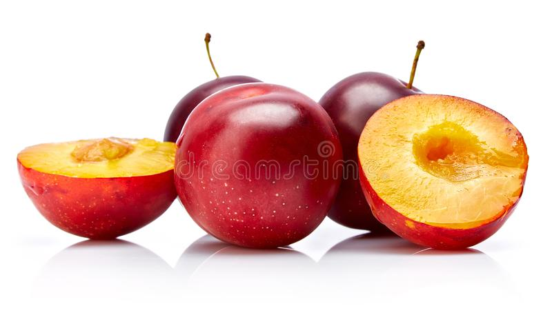 Fresh plum in cut with green leaf. royalty free stock photos