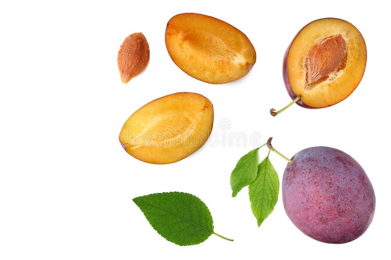 Fresh plum fruit with green leaf and cut plum slices isolated on white background. top view stock photos