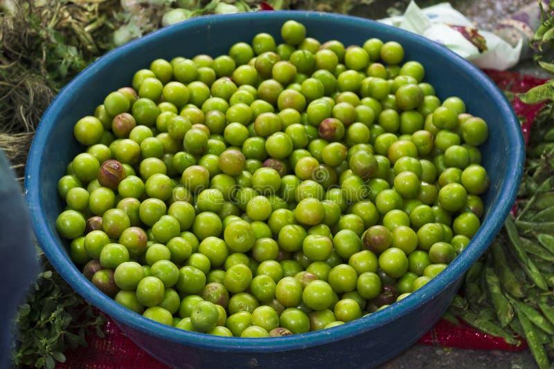 Fresh plum at traditional turkish street bazaar. At the summer season stock photo
