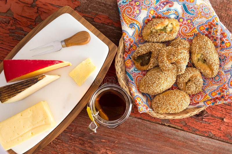 Fresh Poacha Pastries and Cheese on a Wooden Table royalty free stock image