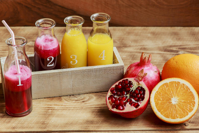 Fresh pomegranate juice and orange squeeze. In a bottle royalty free stock photo