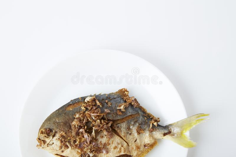 Fresh pomfret deep fried in dish stock image
