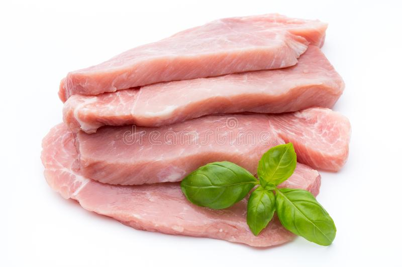 Fresh pork fillet with basil on a white background. royalty free stock images