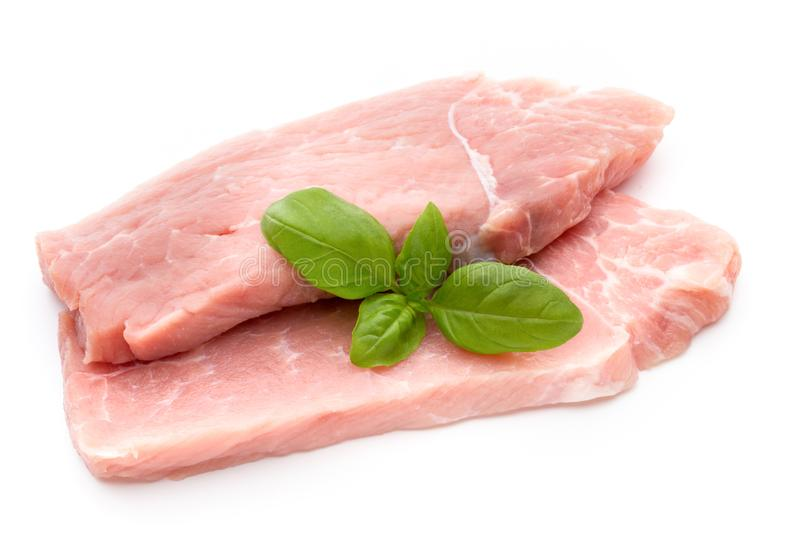 Fresh pork fillet with basil on a white background. stock photography