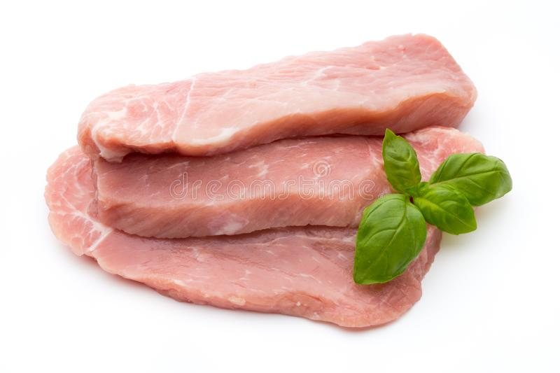 Fresh pork fillet with basil on a white background. royalty free stock photos