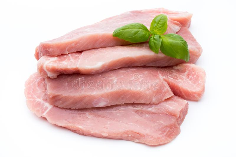 Fresh pork fillet with basil on a white background. stock images
