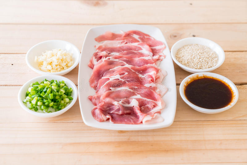 Fresh pork sliced. With ingredients stock image